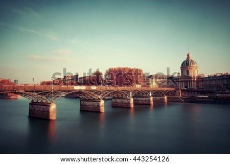 Pont des Arts and Institut de France in Paris, France. #443254126
