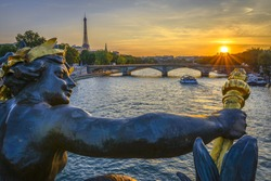 Pont des Invalides and Eiffel tower at sunset from Pont Alexandre III