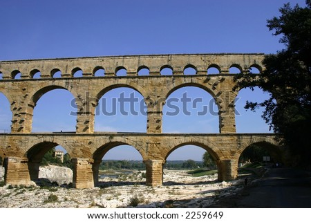 Pont du Gard aqueduct viewed from the river bed - stock photo