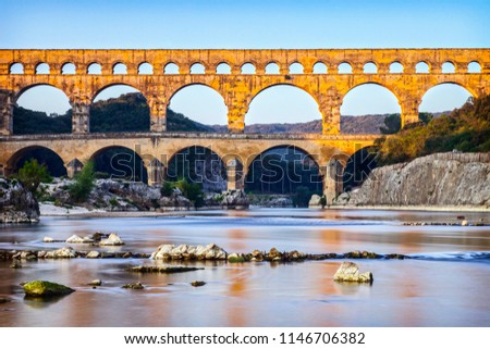 Pont du Gard Roman Aqueduct Languedoc-Roussillon France, in early autumn. This was built by the Romans in the first century AD to carry water from Uzes to Nimes.