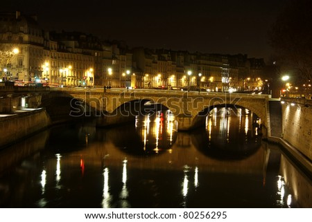 Pont neuf in the night, illuminated and Seine river, Paris, France
