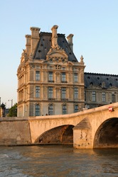 Pont Royal and the Louvre from the Seine River, Paris, France.