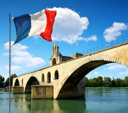 Pont Saint-Benezet with French flag in Avignon, France