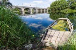 Pont Wilson. Historic bridge over river Loira in Tours, France. Sunken boat