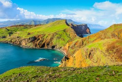 Ponta de Sao Lourenco, Madeira,Portugal. Beautiful scenic mountain view of green landscape,cliffs and Atlantic Ocean. Hiking active day fresh summer scene. Travel holiday background