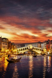 Ponte Rialto and gondola at sunset in Venice, Italy (landscape orientation also available)
