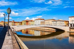 Ponte Solferino bridge and colorful houses at the Arno river waterfront in the centre of Pisa city in Tuscany, Italy