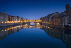Ponte Vecchio bridge and Arno river in Florence at sunset. Blue hour. Tuscany, Italy, Europe.