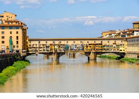 Ponte Vecchio (Old Bridge), a Medieval stone closed-spandrel segmental arch bridge over the Arno River, in Florence, Italy. #420246565