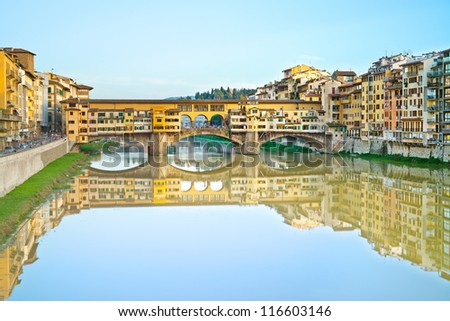 Ponte Vecchio, old bridge, medieval landmark on Arno river and its reflection. Long exposure photography. Florence, Tuscany, Italy.