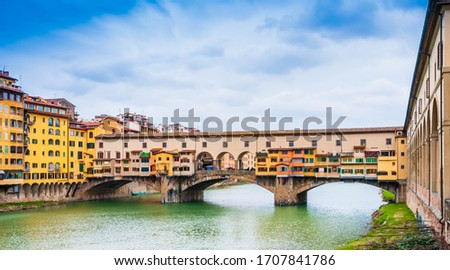 Ponte Vecchio on the Arno river in Florence, Tuscany in Italy stock photo