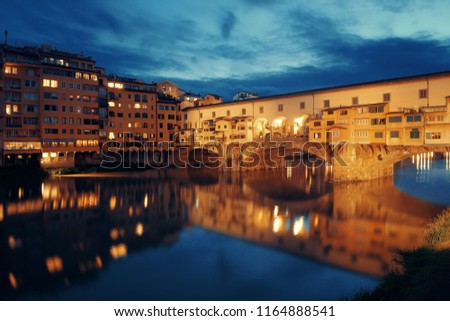 Ponte Vecchio over Arno River at night in Florence Italy.