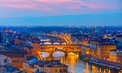 Ponte Vecchio over Arno river at twilight blue hour - Florence, Italy