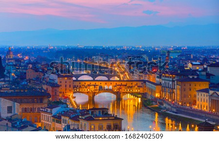 Ponte Vecchio over Arno river at twilight blue hour - Florence, Italy stock photo