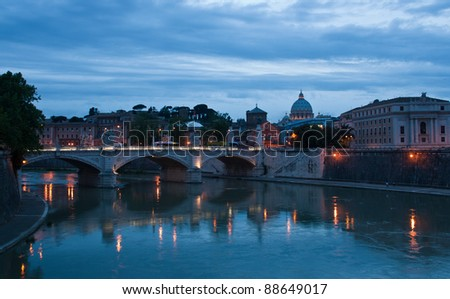 Ponte Vittorio Emanuele II and Basilica of St. Peter with the Vatican in the background  in Rome, Italy. Night view.