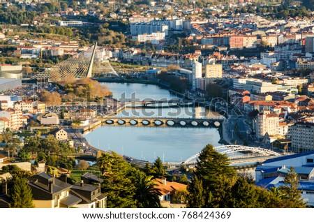 Shutterstock Pontevedra, Galicia. View of Lerez river in the city from an elevated viewpoint. Bridges are Puente de las corrientes, Puente del Burgo, Puente de Santiago, Puente de los tirantes.