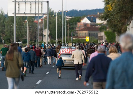 PONTEVEDRA, SPAIN - JUNE 4, 2017: Numerous people walk along a road, at the end of an ecological demonstration. #782975512