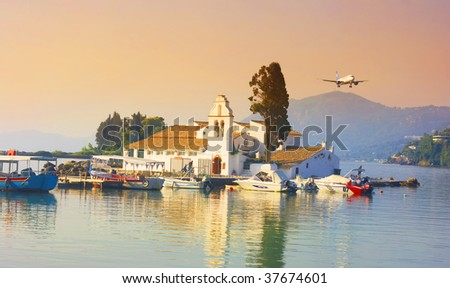 Pontikonisi area at Corfu island with airplane flying, Greece