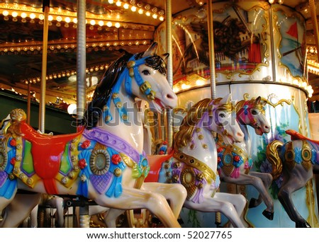 Pony rides on a merry-go-round carousel.