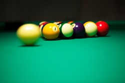 Pool cue ball in movement while breakng in a american pool table