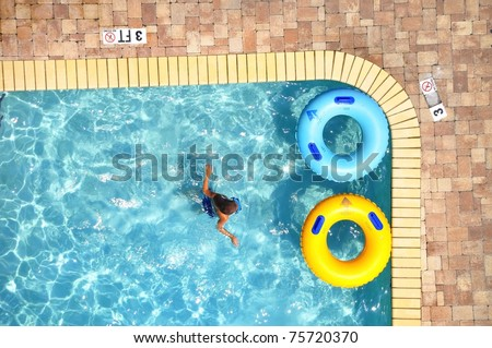 Pool Float in swimming pool, room for your text