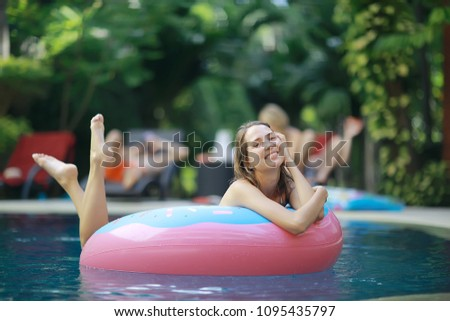 330d0a9c163ed pool girl hotel / summer vacation at the hotel, beautiful young adult girl  resting and