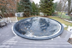 pool has been winterized and cover is in place