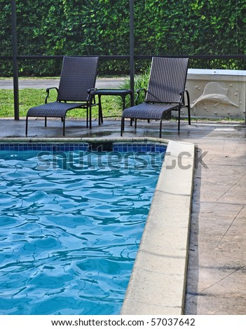 Pool in a House showing Pool furniture and the blue water