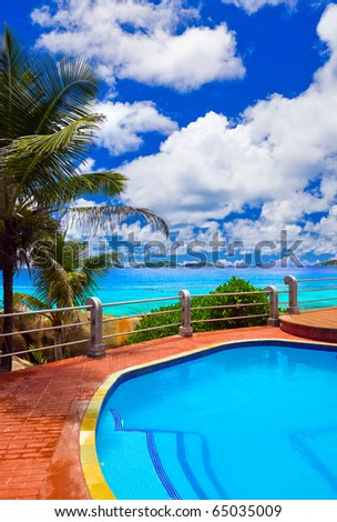 Pool in hotel at tropical beach - vacation background