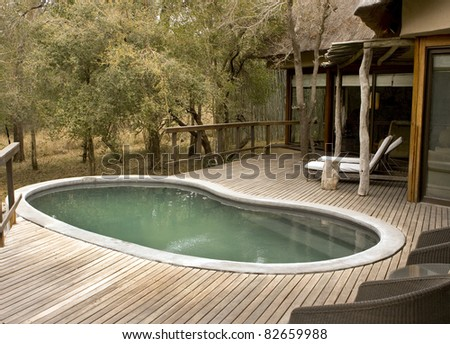 Pool on wooden deck at a lodge on safari in Africa