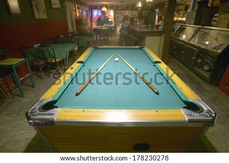 Pool table lit by electric lights in a restaurant and bar in Shoshone, CA near Death Valley National Park