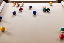 Pool table playing game of billiard with colorful white and color numbered balls