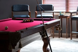 Pool table with ball racked and ready for breaking. The rack is for the game of eight ball.
