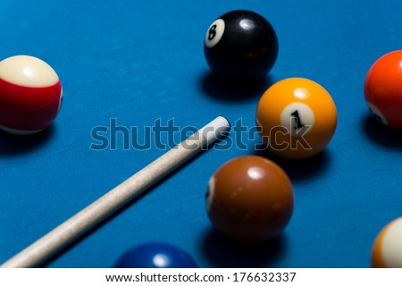 Pool Table With Balls And Cue Stick - Close-Up Of Pool Balls On A Blue Pool Table