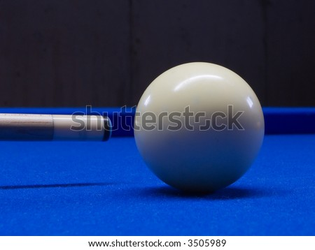 Pool table with cue ball and pool stick