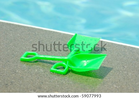 Pool toys by the pool - stock photo