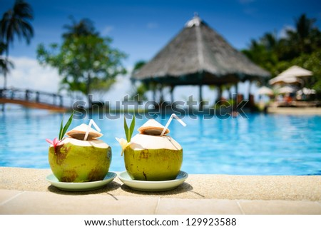pool with artificial beach and tropical ocean #129923588