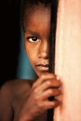 poor african child in the door, village near Kalahari desert, Botswana