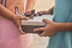 Poor children are accepting gifts,Girl giving gift box to boy