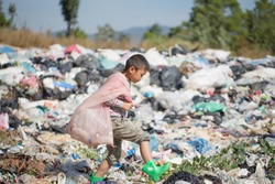 Poor children collect garbage for sale because of poverty, Junk recycle, Child labor, Poverty concept, human trafficking, World Environment Day,