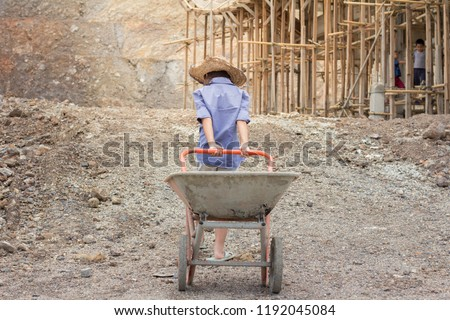Poor children working at construction site against children labour,  World Day Against Child Labour  and trafficking concept.