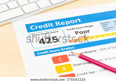 Poor credit score report with pen and keyboard Stock photo ©