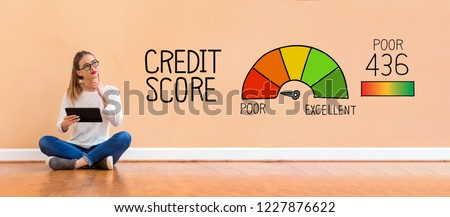 Poor credit score with young woman holding a tablet computer #1227876622