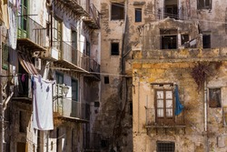 Poor district of Palermo, Sicily, Italy - facade of crumbling building