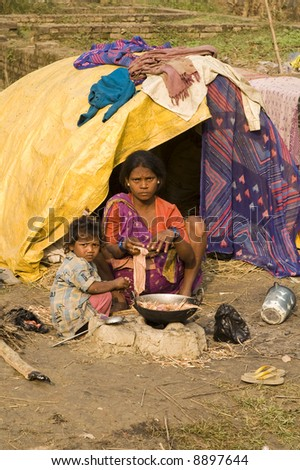 Poor Indian family living in a makeshift shack by the side of the road