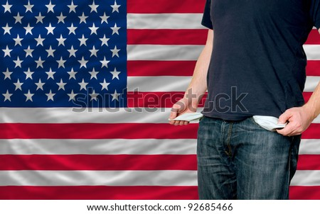 poor man showing empty pockets in front of us flag