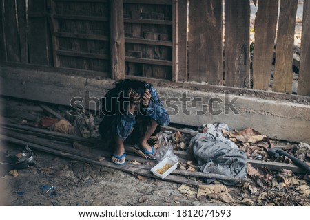 poor people,homeless or beggar begging for help sitting at dirty slum.concept for poverty hunger,human rights,donate and charity for underprivileged children in third world Foto stock ©