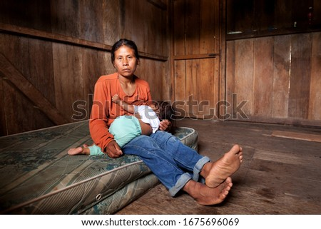 poor poverty mother south america family people amazon baby breastfeeding femininity from amazon breastfeeding seriously distressed by strabismus poor poverty mother south america family people amazon