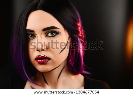 Pop art make up. Woman portrait with purple hair.