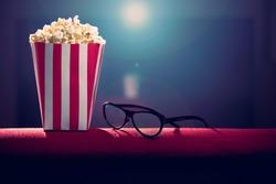 pop corn and 3d glasses on armchair cinema